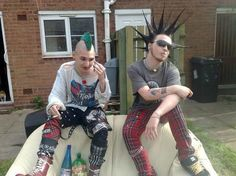 Green mohawk and liberty spikes, plaid pants