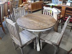 Oak Dining Table w/ White Base  This dining table has been refinished on the surface. The base has been painted white. Has a farmhouse / country feel. The table comes with 2 leaves.  The chairs are sold separately for $65 each.  Table is about 42″ in diameter. Each leaf is 12″.  Item # 1565-873