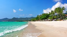 Koh Samui Thailand white sandy beach with beautiful green blue water.