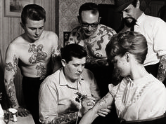 Tattooist Ron Ackers at work in Bristol, Great Britain during the 1950s.