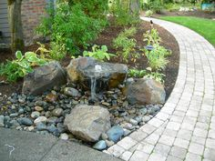 Paver walkway and small water feature by JsCustomLandscaping, via Flickr