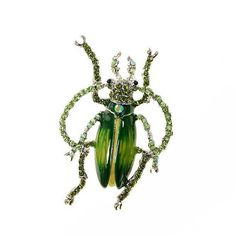 """Insect broach. This beautiful emerald green rhinestone beetle insect brooch will be great for your DIY project – anything wedding, brooch bouquet, decoration for cakes, guest book, candle, pillows, clutch bags and hats, crafts, scrapbooks, hair comb or clip, gift box and much more.  ~ Quantity: 1 pc  ~ Size: approximately 3H x 2W inches  ~ Flat backing. But if you prefer a pin backing so you can use it as a brooch please choose """"Brooch Pin"""". This option is free of charge!  ~ Base: Alloy…"""