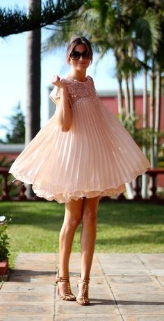 Go ahead, twirl away. That's what pleated pink dresses were made for.