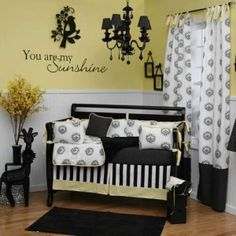 "I don't like black for a nursery but I love the yellow. Most of all I love the quote on the wall. ""You are my Sunshine"""