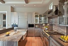 This sleek kitchen features stone countertops from Boynton Beach-based @umistone. | See more: https://luxesource.com/resources/umi-the-source?utm_source=pinterest. | #luxeFL