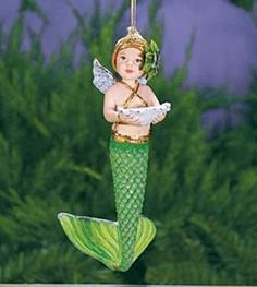 Merbaby Ornament from Patience Brewster is in stock. Decorate your holiday tree with this unique, hand painted ornament.