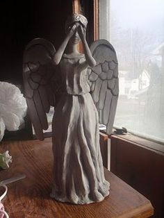 Weeping Angel Christmas Tree Topper!  Made from a barbie doll, soda bottle, clay, and paint. Non-Whovians need not apply.