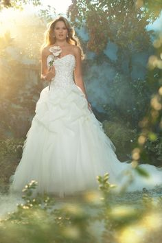 Stunning strapless ball gown with beaded bodice and dramatic ruffle skirt.