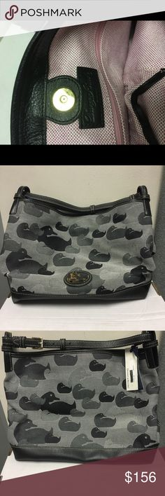 Black/Grey duck pattern, medium Dooney & Bourke NWT. From Dooney & Bourke factory outlet. Cross stitch style pattern. Pattern is black and various grey tones. Medium sized purse. Black leather. Issue is a black mark on the inside bottom of the purse. Dooney & Bourke Bags Shoulder Bags