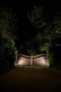 Things We Love: Garden Gates - Design Chic love the lights on the gates