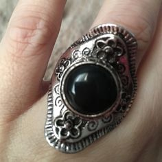 Vintage Silver plated adjustable saddle ring. Vintage Silver plated with black stone adjustable saddle ring. Sure to fit any size. Fun costume jewelry. Jewelry Rings