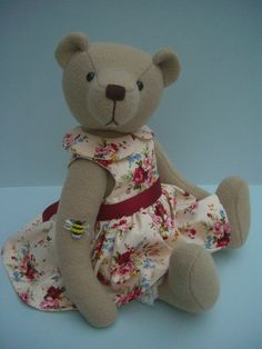 This little bear is tall and made from wool fabric. She is firmly filled with polyester fibre and her nose is hand embroidered. She has my trademark handmade b. Bear Design, Wool Fabric, Is 11, Applique Designs, Teddy Bears, Kids Toys, Doll Clothes, Arms, Plush