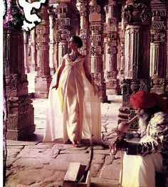 1956 - Wearing an evening gown by Dior, photo by Norman Parkinson taken at 'The pillars of Quwat-Ul-Islam Mosque', Dehli, India.