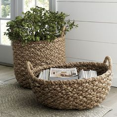 Chunky braids of rustic bankuan leaves weave a tall textural basket, ready to stow toys, towels, magazines and more. Sturdy handles are soft to the touch but strong enough for carting stored items. Casual storage option adds a warm natural touch to any room.