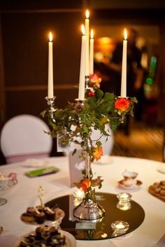 Candelabra, candles, roses, ivy. Vintage tea cups. Wedding table styled by Jessie Thomson Weddings & Events and Planned for Perfection, with flowers by Rose & Grace.    www.jessiethomson.co.uk
