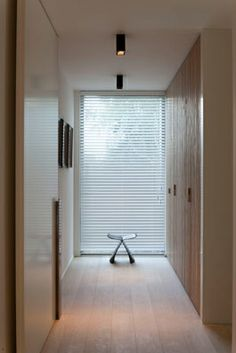 Hallway with built-in storage by Aerts + Blower architects _