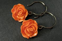 Rose Dangle Earrings in Bronze. Rose Earrings. Rose Jewelry. Handmade Jewelry. (PICK YOUR COLOR) by StumblingOnSainthood from Stumbling On Sainthood. Find it now at http://ift.tt/1r7ETh2!