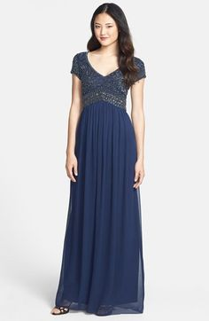 Free shipping and returns on Adrianna Papell Embellished Cap Sleeve Gown at Nordstrom.com. Intricate embellishment brings the romance of the Renaissance to a stunning evening gown designed for pure flattery. The cap-sleeve bodice is styled with a wide V-neckline and inverted-V Empire waist that elongates the figure before the gently gathered skirt flows to a floor-sweeping finish.