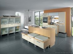 #Kitchen Idea of the Day: Modern Cream-Colored Kitchen (By ALNO, AG) with a unique island bench.