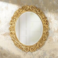 A gorgeous traditional mirror design with a highly decorative acanthus leaf frame in a gold leaf finish.