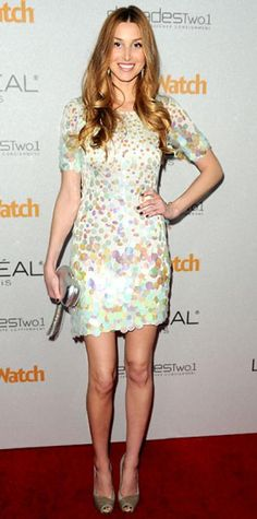 Look of the Day › January 30, 2011 WHAT SHE WORE Port worked a paillette-trimmed mini, gray heels and a metallic clutch at a People Stylewatch bash.