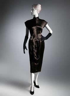 1944 Although the bodice of this dress has center front, center back, and side seams, its second-skin fit was accomplished by molding the bust à calage (steaming in the shape) and using back shoulder darts