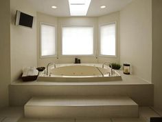 jetted bathtub with tile surround