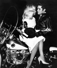 Elvis and friend his Harley