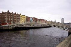 Spanning the River Liffey in Dublin, Ireland, this cast-iron pedestrian bridge is commonly called the Ha'penny Bridge because of the short-lived toll once required to cross it. Known asDroichead na Leathphingine in Irish Gaelic, it opened in 1816 and currently accommodates nearly thirty thousand pedestrians every day.