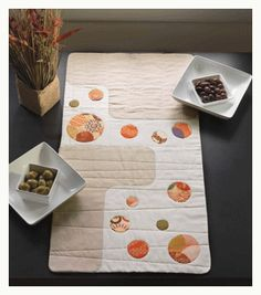 This is a cool modern table runner  applique quilt table runner by brigitte heitland