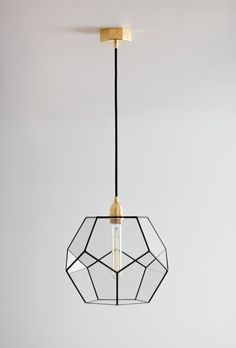 ▶︎Minimalistic and stylish Dodecahedron chandelier with Edison retro bulb◀︎ (The main photo shows an option - 12'' Black + Brass Fixture)  The dodecahedron is one of the five possible regular polyhedra.  The dodecahedron is made up of twelve regular pentagons, which are its faces. Each vertex of a dodecahedron is the vertex of three regular pentagons. Thus, the dodecahedron has 12 faces (pentagonal), 30 edges and 20 vertices (in each 3 edges converge). Entryway Light Fixtures, Foyer Lighting, Pendant Lighting, Geometric Pendant Light, Black Pendant Light, Kitchen Island Lighting, Kitchen Pendants, Retro Home Decor, Glass Chandelier