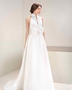 Jesus Peiro's Mikado halter neck wedding gown is an ideal example of the contemporary revision of the traditional bow.