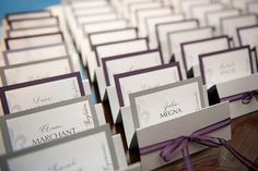 Wedding place card display.. different colored paper on back for meal choice