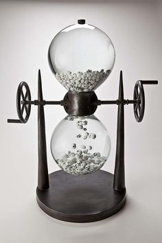 Wasting Time, a turn-crank hourglass (with skulls for sand grains) meets bubble-gum machine meets aquarium meets steampunk. By Ed Wicklander.