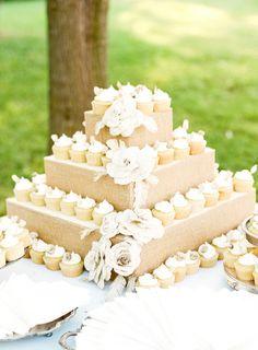 Rustic white wedding cupcake display