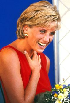 Laughter...Princess Diana.  Unusual to see such laughter from this beautiful Royal Beauty.