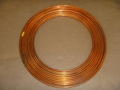 Beginning at $5.00: Approx. 50 ft. coil of 1/8 o.d. soft copper refrigeration tube as shown.