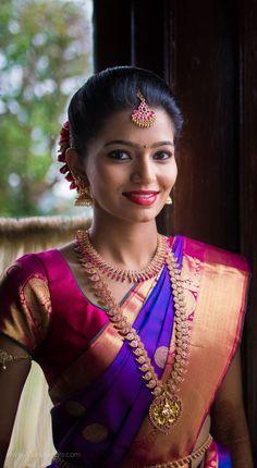 South Indian bride. Gold Indian bridal jewelry.Temple jewelry. Jhumkis.Purple blue silk kanchipuram sari.braid with fresh jasmine flowers. Tamil bride. Telugu bride. Kannada bride. Hindu bride. Malayalee bride.Kerala bride.South Indian wedding.