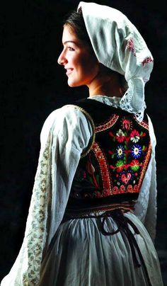 Europe | Portrait of a woman wearing traditional clothes and headscarf, Srem, Serbia #embroidery