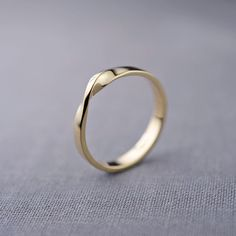 14K Gold Mobius Ring | 14K Gold Wedding Band | Recycled 14K Gold by LilyEmmeJewelry on Etsy https://www.etsy.com/listing/220851266/14k-gold-mobius-ring-14k-gold-wedding