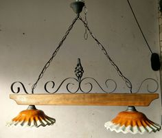 Lampadario rustico in ferro battuto e legno terracotta mod. Ruota di ...