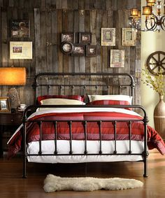 The bed frame and the wood paneling