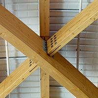 The glulam beams are connected by steel flitch plates. Photo: Aukett Fitzroy Robinson