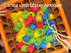 "Lacing with Water Noodles--my preschool kids are loving this- but they like smaller beads better- to make necklaces. They call this one ""snakes"""