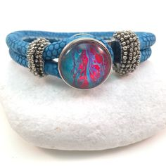 A personal favorite from my Etsy shop https://www.etsy.com/listing/186819041/blue-leather-bracelet-snap-jewelry-noosa