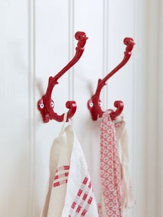 Need a touch of red in the back hall.  Either paint the hooks of perhaps do black hooks mounted against a red board.