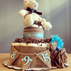 Image from http://www.babyshower-decorations.com/wp-content/uploads/rustic-shabby-chic-diaper-cake-with-burlap-pendant-4.jpg.