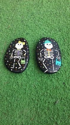 Boy & girl skeletons painted on Lake Huron beach stone's