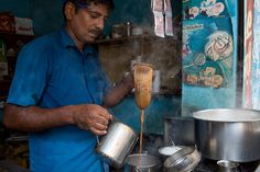 Some java jockeys -- such as this vendor in #Chennai capital of Tamil Nadu state -- use the sock method, pouring hot water or milk through fine grounds in a piece of muslin suspended from a metal ring. #Coffee #Street #Food #India #ekPlate #ekplatecoffee