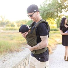 """Nate Adam & wife count on Baby Tula baby carriers with their twins. """"This thing is amazing! With twins, my wife and I find it extreme difficult to have a free hand most of the time... Your product makes a difference. Especially on a busy day like today, we are away from home with both boys, juggling babies, bags, strollers, and the rest of it, haha."""" Another babywearing family :)"""